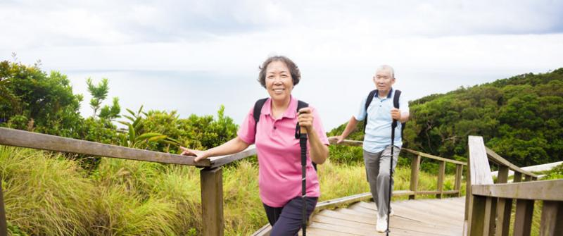 Photo of a senior couple walking up a gently sloped path