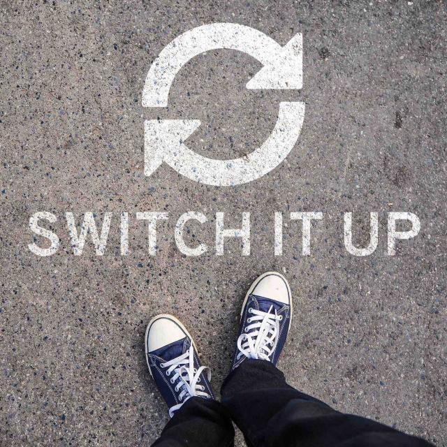 "image of person's shoes with text ""switch it up"" underneath two arrows pointing in a circle"