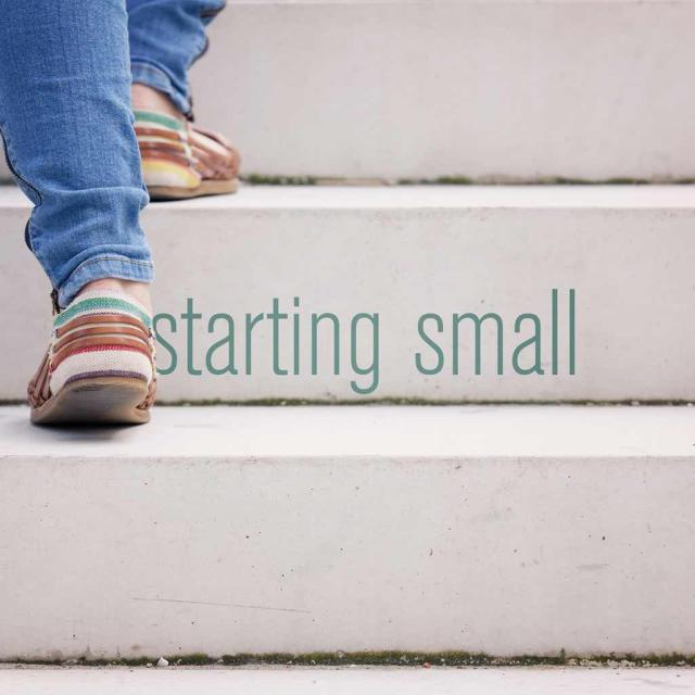 "Feet walking up stairs with text saying ""starting small"""