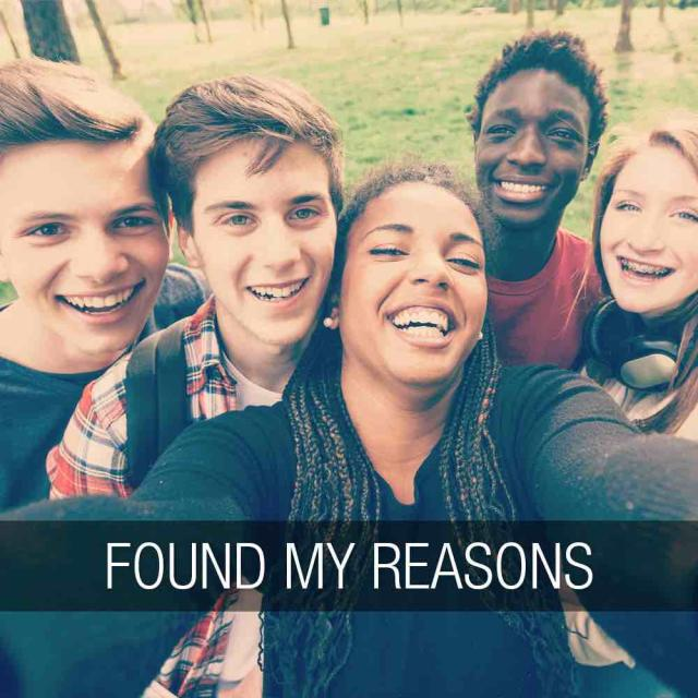Group of teens gathered together to take a selfie with text stating 'found my reasons'