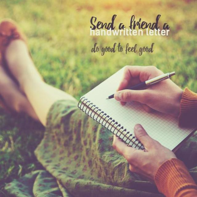 "A woman sits in the grass wearing a skirt and holding a notebook and pen in her lap. The text reads, ""Send a friend a handwritten letter. do good to feel good."""""