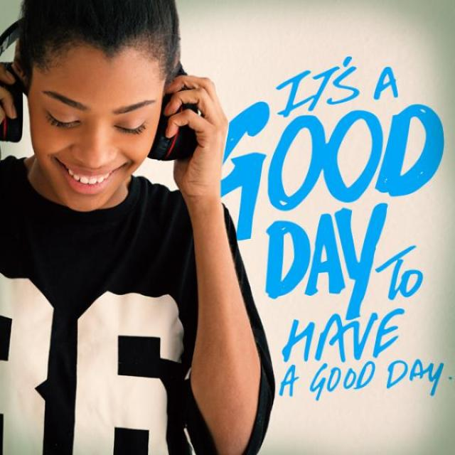 "Image of a teenager in headphones with the caption, ""It's a good day to have a good day."""